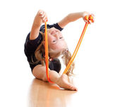 Young girl doing gymnastics over white background — Stok fotoğraf