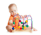 Pretty baby with color educational toy — Foto de Stock