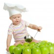Funny child with green apples healthy food — Stock Photo #9015804