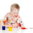Happy dirty child with paints. Isolated on white background — Stock Photo