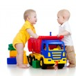 Foto Stock: Two little children playing with color toys