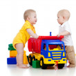 Stockfoto: Two little children playing with color toys