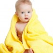 Adorable happy blue-eyed baby in colorful towel — Stock Photo #9016120