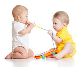 Funny children playing with musical toys. Isolated on white bac — Stok fotoğraf