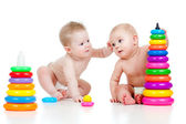 Children playing with color developmental toys — Stock Photo