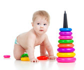 Baby playing with color developmental toy — Stock Photo