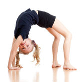 Young girl doing gymnastics over white background — Stock Photo