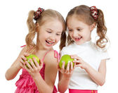 Two schoolfriends or sisters with green apples healthy food isol — Stockfoto