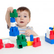 Little cheerful child with construction set over white backgroun — Stock Photo #9114140