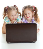 Smart girlfriends are smiling and looking at the laptop — Стоковое фото
