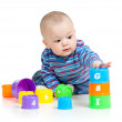 Baby is playing with educational toys, isolated over white — Stock Photo #9212957