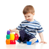 Funny little child is playing with color toys, isolated over whi — Stock Photo