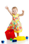 Little cheerful girlwith construction set over white background — Stock Photo