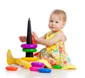Pretty little girl playing with color toy — Stock Photo