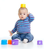 Funny little child is playing with cup toys, isolated over white — Stock Photo