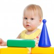 Little girl playing with colorful building blocks toys. Isolated — Stock Photo