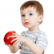 Attractive child holding red apple, isolated on white — Stock Photo