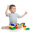 Little cheerful child with construction set over white backgroun — Stock Photo #9442397