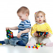 Children playing with mosaic toy — Foto de Stock
