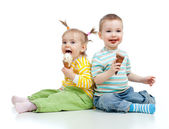 Happy children little girl and boy with ice cream in studio isol — Stock Photo