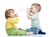 Boy and girl drinking juice from glass — Stock Photo