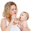 Mother feeding her baby by spoon — Stock Photo #9485560