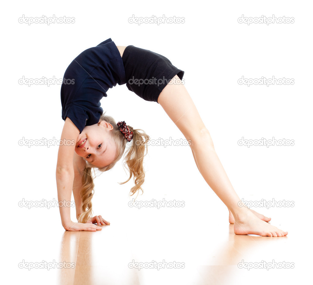 Young girl doing gymnastics over white background - Stock Image