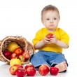 Little boy with healthy food. Near basket with apples. — Stock Photo