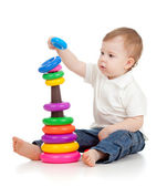 Child playing with color pyramidion — Stock Photo