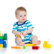 Little cheerful child with construction set over white backgroun — Stock Photo #9823307