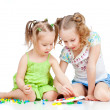 Elder sister training young one to collect mosaic toy over white — Foto Stock