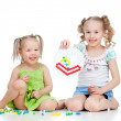 Cute girls sisters playing together over white background — Stockfoto #9823475