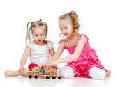 Elder sister training and playing with young one to collect mosa — Stock Photo