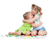 Sisters girls playing and embracing over white background — Stock Photo