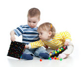 Children playing with mosaic toy over white background — Stock Photo