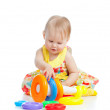Smiling little girl playing with color toy — Stock Photo