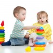 Two little children playing with color toys — ストック写真