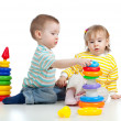 Two little children playing with color toys — Stockfoto