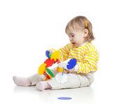 Little child assembling construction set over white background — Stock Photo