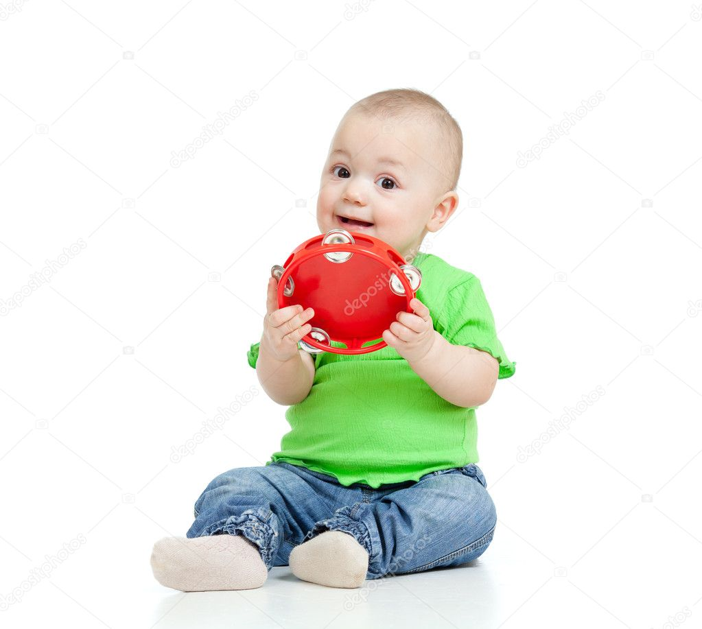 Child playing with musical toy. Isolated on white background  Stock Photo #9935149