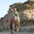 Bedouin with stick — Stockfoto