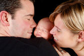 Happy couple with baby — Stock Photo