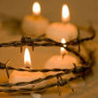 Fence and candles — Stock Photo