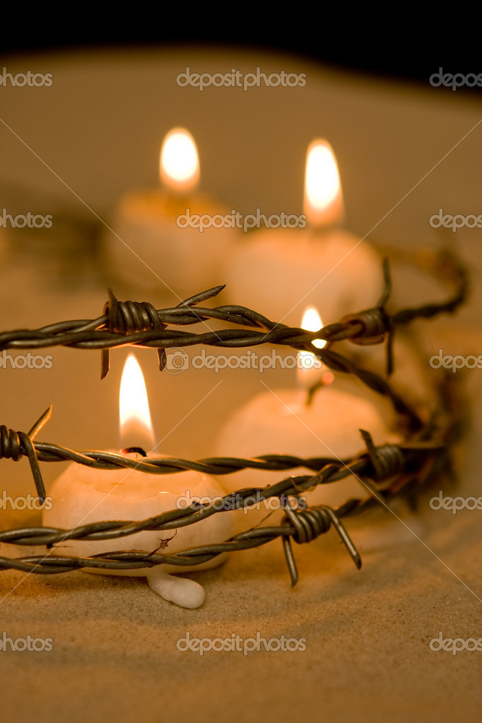Burning candles behind barbed wire, symbol of hope — Photo #10370330