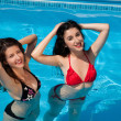 Girl-friends in the swimming-pool — Stock Photo #10381847
