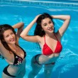 Girl-friends in the swimming-pool — Stock Photo