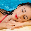 Woman resting after a swim — Stock Photo #10381855