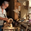 Wood worker in old shed — Stock Photo #10405210