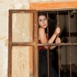 Sad woman behind bars — Foto de Stock