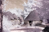 Stone huts in infrared — Stock Photo